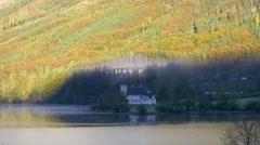 4K beautiful chateau on Austrian lakeside in autum Stock Footage