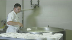 Ricottaman is working a small dairy: production o typical italian fresc cheese Stock Footage