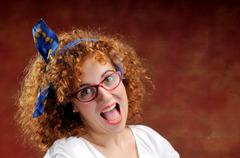 funny red-haired girl shout out - stock photo
