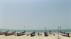 Row boats on shore at Agonda Beach , Goa-India Stock Footage