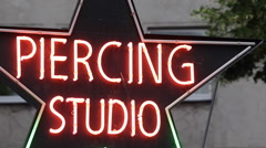 Body Piercing Studio Neon Sign Light Street Outdoor Signage Colorful Advertising Stock Footage