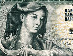 farm woman with sickle on 5 dinara 1968 banknote from yugoslavia. - stock photo