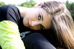 closeup portrait of young female teenager smiling - stock photo