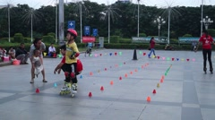 The square skating children, in China Stock Footage