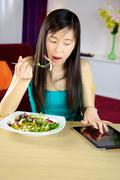 Stock Photo of eating with tablet