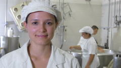 Producing cheese: worker inside typical italian dairy factory Stock Footage