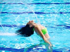 Flying long hair in swimming pool in summer Stock Photos