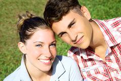 Happy beautiful couple smiling Stock Photos