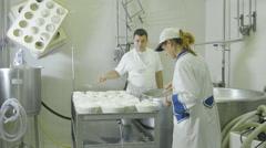 people working inside an italian dary farm: making ricotta, fresh cheese - stock footage
