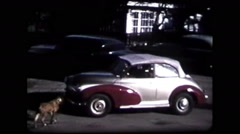 Silver & purple car driving off (vintage 8mm home movies) Stock Footage