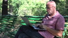 Sales Man Bench Sitting Work Using Laptop Relaxed Activity in Nature Environment Stock Footage
