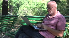Sales Man Bench Sitting Work Using Laptop Relaxed Activity in Nature Environment - stock footage