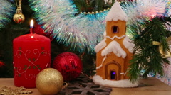 Christmas decoration - candle, house, snowflakes and balls - stock footage
