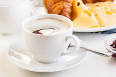 hot coffee in the morning breakfast. focus on coffee - stock photo