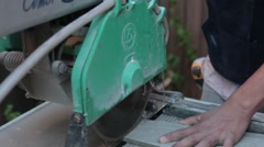 Cutting Tile with a wet saw tight shot.mp4 Stock Footage