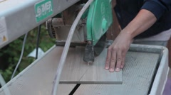 Cutting tile with a wet saw medium shot.mp4 Stock Footage