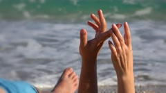 Close up of playful couple hands and fingers, sea waving  Stock Footage