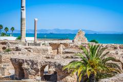 Ancient ruins at carthage, tunisia with the mediterranean sea in the backgrou Stock Photos