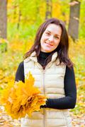 Stock Photo of brunette with bouquet from sheets