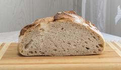 Freshly baked homemade bread dusted with flour Stock Photos