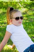 cute girl in sunglasses - stock photo