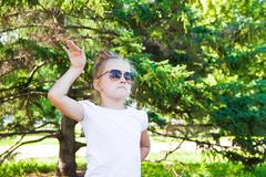 cute dancing girl in sunglasses - stock photo