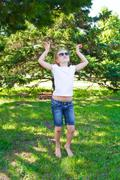 Dancing girl in sunglass with sore knee Stock Photos