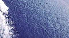 Beautiful blue sea ship bow wave wake Stock Footage