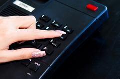 Finger press the phone Stock Photos