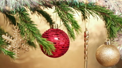 Christmas holiday toys on fir tree twig and wood background Stock Footage