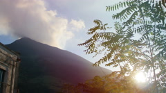Vulcano island landscape: sun through the leaves of a tree: volcano background Stock Footage