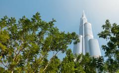 Burj khalifa vanishing in blue sky in dubai, uae. Stock Photos