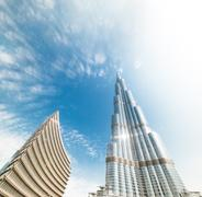 burj khalifa vanishing in blue sky in dubai, uae. - stock photo