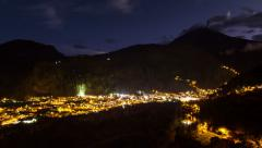Time lapse video, day to night transition over Banos city, Ecuador Stock Footage