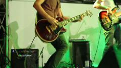 Rock musician playing solo Gibson electric guitar, Rock band at live concert Stock Footage