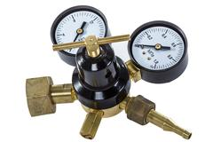 Stock Photo of gas pressure regulator with manometer, isolated with clipping path