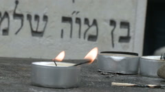 Memorial candel in a Jewish cemetery Stock Footage