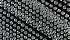 Loopable waving gemstones or diamonds on black material. Alpha Stock Footage