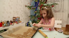 Little girl baking Christmas cookies Stock Footage