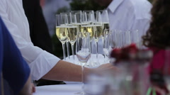 waiter brings a tray with glasses of champagne - stock footage