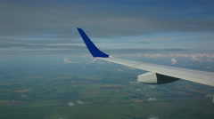 View from the cabin porthole of an airliner Stock Footage