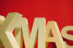 colorful xmas letters on red background for christmas - stock photo