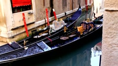Two old  gondolas in the small canal of Venice Stock Footage