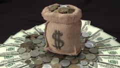 Money bag rotates over money Stock Footage