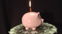 moneybox rotates over money - stock footage