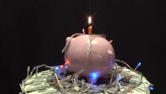 moneybox rotates over money with a garland - stock footage