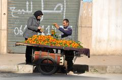 Woman Buying Tangerines - stock photo