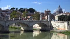 Graffiti on Tiber flood walls; church bells, scenic St. Peter's in BG 4k Stock Footage