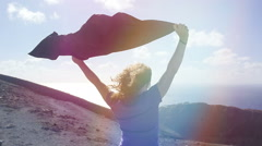 Peaceful and happy woman with raised arms in the wind: freedom, summer Stock Footage