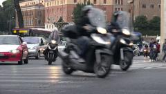 Roman Motorcylces lead traffic, low angle Stock Footage